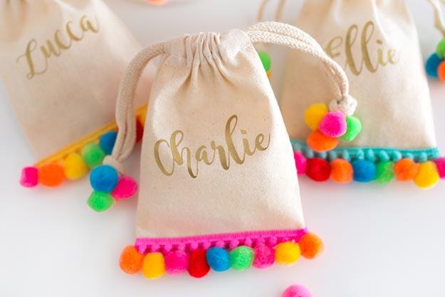 Pom Pom Crafts - No Sew Mini Pom Pom Bag Tutorial - Easy DIY Decor and Craft Ideas Made With Pom Poms - Homemade Room Decor for Teens and Adults - How to Make A Pom Pom Tutorial - Tissue Paper and Yarn Crafts to Make and Sell On Etsy #teencrafts #pompomcrafts #diyideas